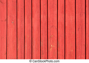 Close up of red painted wooden fence panels
