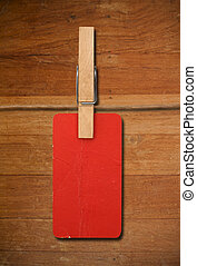 close up of red post it reminders and clothespins on wood
