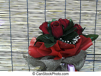 Close up of Red rose flowers in bamboo backgrounds