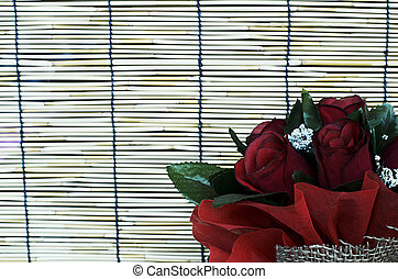 Close up of Red rose flowers in bamboo curtain backgrounds