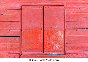 Close up of red waindow on wooden wall