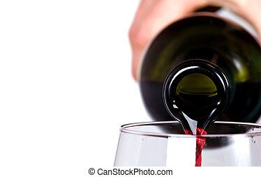 close up of red wine pouring in the glass