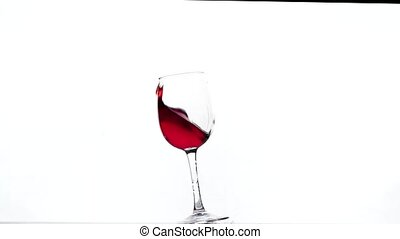close-up of red wine swirling in a glass