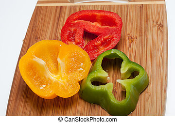 close up of red, yellow and green peppers