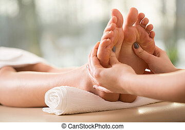 Close-up of reflexology - Close-up of young woman having...