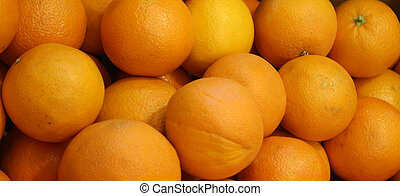 Close up of Ripe orange citrus on the counter market stall.