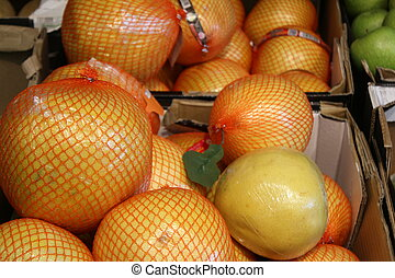 Close up of Ripe pomelo or thai grapefruit on the counter market