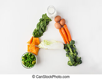 healthy eating, vegetarian food, diet and culinary concept - close up of ripe vegetables in shape of a letter