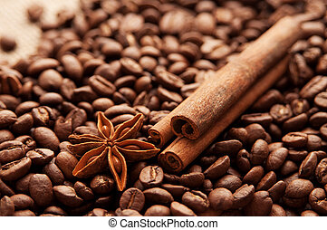 Close up of roasted coffee beans, star anise and cinnamon sticks