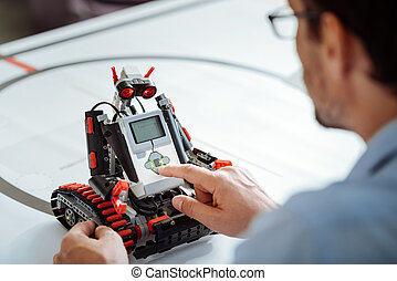 Close up of robot being checked by professional engineer