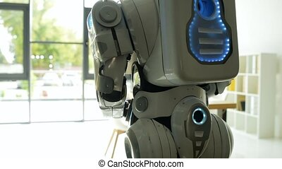 Close up of robot walking in office - The world is calling....