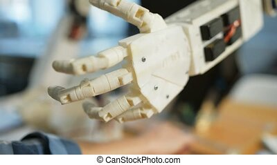 Close up of robots hand in the workroom