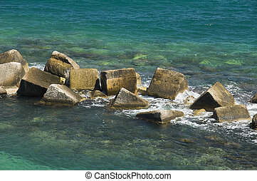 Close up of rocks in sea.