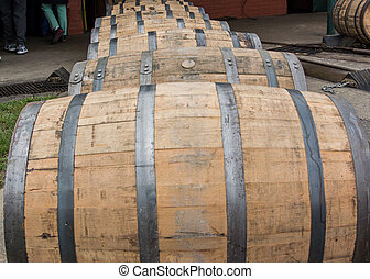 Close up of Rolling Bourbon Barrels waiting to be emptied