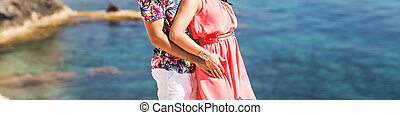 Close-up of romantic young couple on the beach