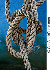 Close up of rope with a knot on fisherman's boat.