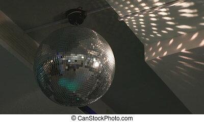 Close-up of rotating disco mirror ball