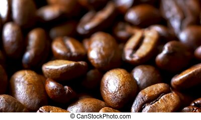 Close-up of Rotating Roasted Coffee Beans, Blurry Background...