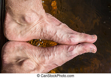 Close up of rough feet with veins.