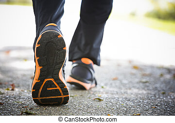 close up of running shoes on asphalt