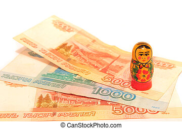 Close up of russian rubles with matryoshka