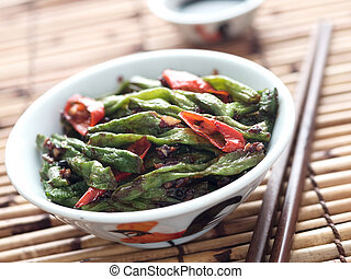 close up of rustic chinese long snake bean stir fry