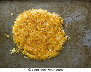 rustic golden crispy swiss rosti - close up of rustic golden...