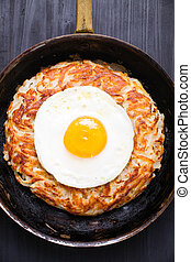 rustic golden swiss rosti potato - close up of rustic golden...