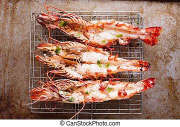 rustic grilled jumbo prawn - close up of rustic grilled...