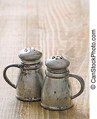 rustic salt and pepper shaker - close up of rustic salt and ...