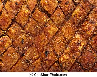 rustic scored golden roasted pork belly skin background