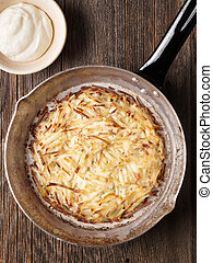 rustic swiss potato rosti - close up of rustic swiss potato ...