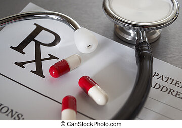 Close-up of RX prescription and stethoscope on stainless steel desk