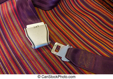 Close up of safety seat belt in the airplane .