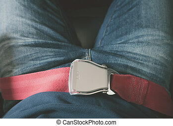 Close up of safety seat belt in the airplane .( Filtered...