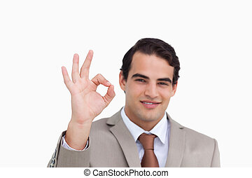 Close up of salesman giving his approval against a white background