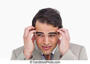 Close up of salesman having a headache