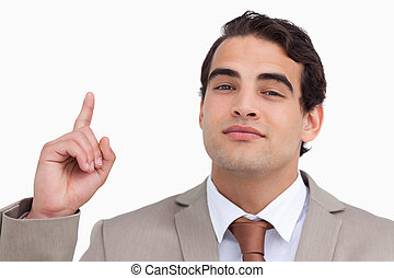Close up of salesman pointing up against a white background
