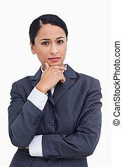 Close up of saleswoman thinking
