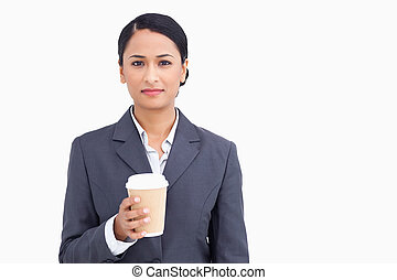 Close up of saleswoman with paper cup