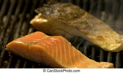 Close up of salmon fillet cooking on the grill.