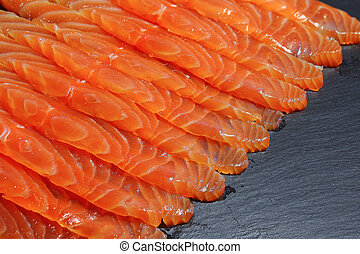 close-up of salmon slices on tray