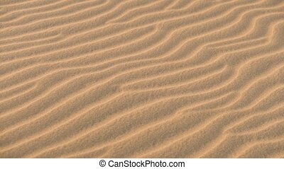 close up of sand dunes pattern texture in desert. - close up...