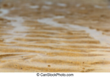 Close up of sand on the beach Out of focus.