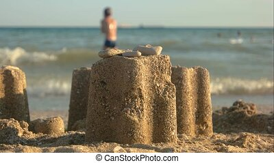 Close up of sand tower.