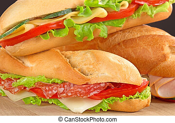 sandwiches with savoury fillings - close up of sandwiches...