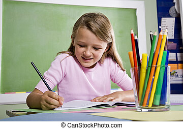 Close-up of school girl writing in notebook - Back to school...