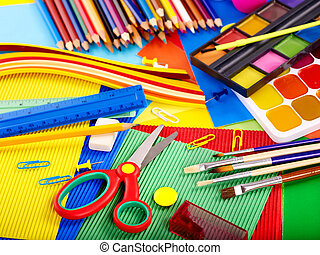 Close up of school supplies. - Close up of group writing...