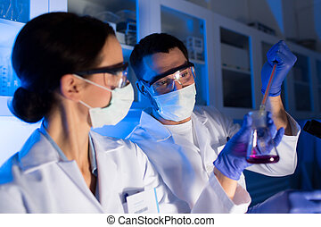 close up of scientists making test in lab