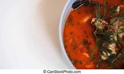 close up of seafood soup with fish and mussels - food, new...